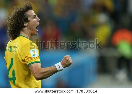 SAO PAULO, BRAZIL - June 12, 2014: Luiz of Brazil celebrates a goal during the World Cup Group A opening game between Brazil and Croatia at Corinthians Arena. No Use in Brazil. - stock photo