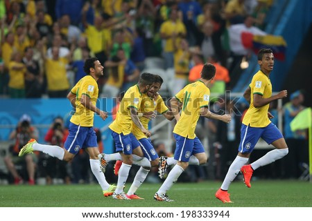 SAO PAULO, BRAZIL - June 12, 2014: Neymar, and Alves of Brazil celebrate their goal during the World Cup Group A opening game between Brazil and Croatia at Corinthians Arena. No Use in Brazil. - stock photo
