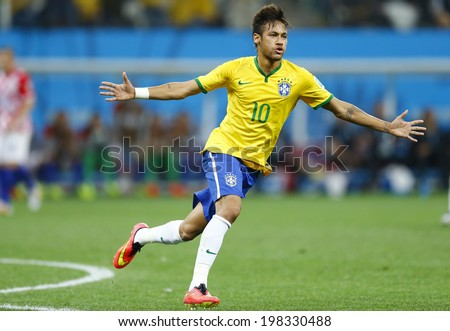 SAO PAULO, BRAZIL - June 12, 2014: Neymar of Brazil celebrates a goal during the World Cup Group A opening game between Brazil and Croatia at Corinthians Arena. No Use in Brazil. - stock photo