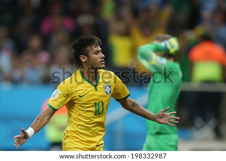 SAO PAULO, BRAZIL - June 12, 2014: Neymar of Brazil celebrates a goal during the World Cup Group A opening game between Brazil and Croatia at Corinthians Arena. No Use in Brazil.