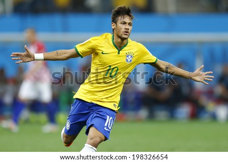 SAO PAULO, BRAZIL - June 12, 2014:Neymar of Brazil celebrates during the World Cup Group A opening game between Brazil and Croatia at Corinthians Arena. No Use in Brazil. - stock photo