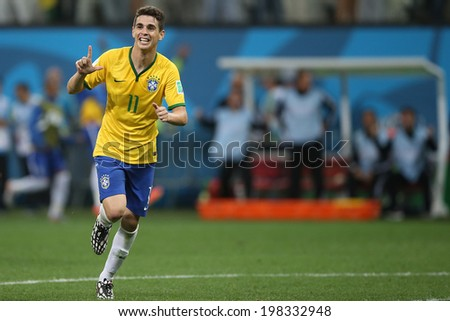 SAO PAULO, BRAZIL - June 12, 2014: Oscar of Brazil celebrate during the World Cup Group A opening game between Brazil and Croatia at Corinthians Arena. No Use in Brazil. - stock photo