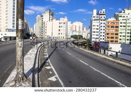 Sao Paulo, Brazil, June 09, 2013: People have fun in a high road, closed to cars on Sundays and holidays, in downtown Sao Paulo