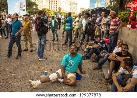 SAO PAULO, BRAZIL - June 16, 2014: Soccer fans during the World Cup Group in the arena FIFA fan fest on Anhangabau Valley