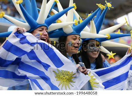 SAO PAULO, BRAZIL - June 19, 2014: Uruguay fans celebrating at the 2014 World Cup Group D game between Uruguay and England at Arena Corinthians. No Use in Brazil. - stock photo