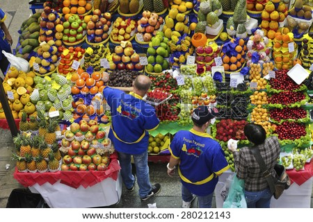 SAO PAULO/BRAZIL - MAY 9: An unidentified vendor at a fruit stand in Central Market of Sao Paulo. This landmark is a famous destination for tourists and locals.