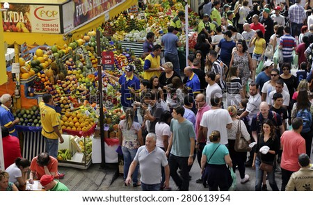 SAO PAULO/BRAZIL - MAY 9: An unidentified vendor at a fruit stand in Central Market of Sao Paulo on May 09, 2015. This landmark is a destination for tourists and locals. - stock photo