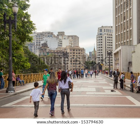 SAO PAULO, BRAZIL - MAY 29: Unidentified People walk in Santa Efigenia viaduct on May 29, 2013 in Sao Paulo, Brazil. Santa Ifigenia Viaduct is located in downtown with exclusive use for pedestrians. - stock photo