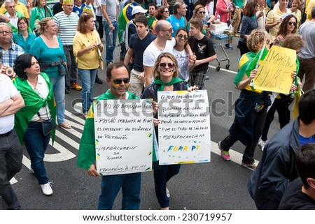 Sao Paulo, Brazil - November 15. Protesters marching on Paulista Avenue holding signs with messages against the corruption in brazilian goverment on November 15th, 2014 in Sao Paulo, Brazil.