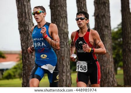 SAO PAULO, BRAZIL - NOVEMBER 24, 2013: Triathletes during the run stage in the Long Distance Pirassununga - stock photo