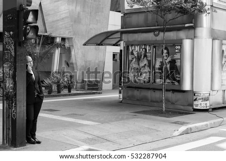 SAO PAULO, BRAZIL - OCTOBER 30, 2016: An unidentified man stands alone in Paulista Avenue.