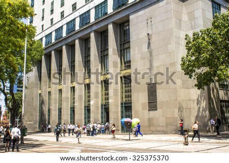 Sao Paulo, Brazil, October 08, 2015. Pedestrian in Joao Mendes Square and entrance of Forum Joao Mendes, downtown Sao Paulo, Brazil - stock photo