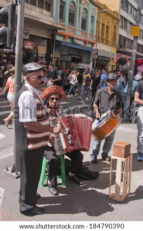 Sao Paulo - September 21: Forro musical trio playing in the street of Sao Paulo- Sao Paulo, Brazil, september 21, 2013. - stock photo