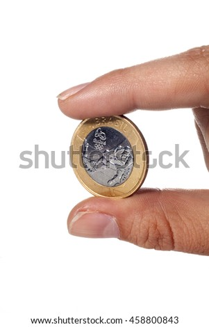 SAO PAULO, SP/BRAZIL, JUNE 28, 2016: Hand holding a commemorative Olimpic Sports coin of Brazil. One real coin isolated on white background. Illustrative editorial image.