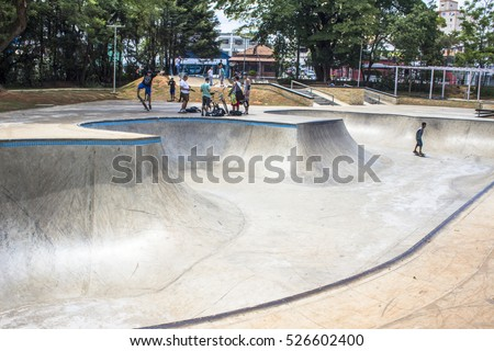 Sao Paulo, SP, Brazil, November 06, 2016. SYoung Skateboarder while performing skateboarding on the edge at skate park of the Chacara do Jockey Park, west of Sao Paulo