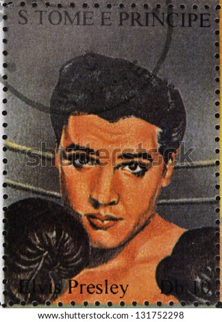 SAO TOME AND PRINCIPE - CIRCA 1995: A stamp printed in Sao Tome and Principe shows image portrait of famous American singer Elvis Presley (1935-1977), circa 1995. - stock photo