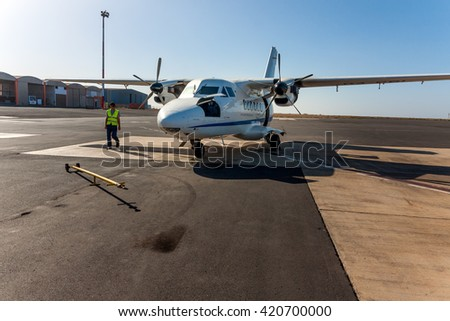 SAO VICENTE, CAPE VERDE - DECEMBER 12, 2015: Small local propeller powered passenger aircraft, Cesaria Evora Airport. Cabo Verde, Africa - stock photo