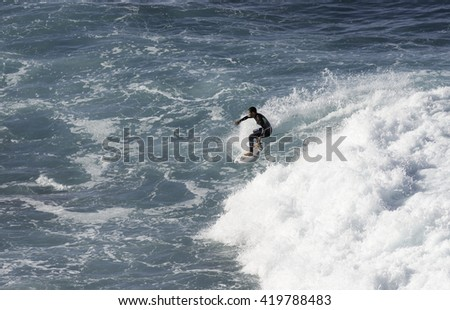 SAO VINCENTE,PORTUGAL-MARCH 24 Unidentified boy surfing on the big waves at the north coast of Madeira on MArch 23,2016 in Sao Vincente,Sao Vincente had the biggest waves at the portugal coast