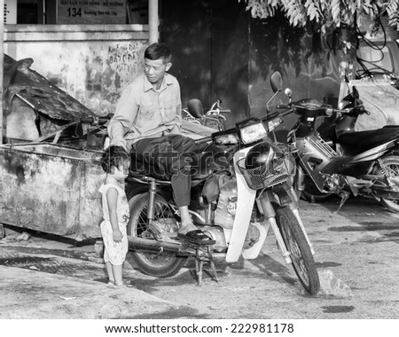 SAPA, VIETMAN - SEP 22, 2014: Unidentified Vietnamese man over a motorbike in Sapa, Vietnam. 86% of Vietnamese people belong to the Viet ethnic group