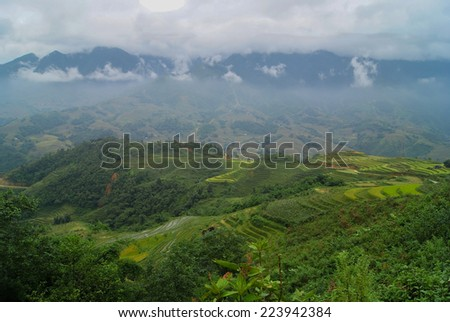 Sapa, Vietnam. Clouds over the green mountains. - stock photo