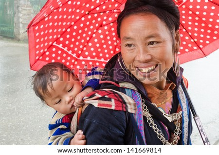 SAPA, VIETNAM - DEC 02: Unidentified H'mong woman in Sa Pa, Vietnam December 02, 2012. Sapa is a mountain town in Vietnam and H'mong are the 8th largest ethnic group in Vietnam. - stock photo