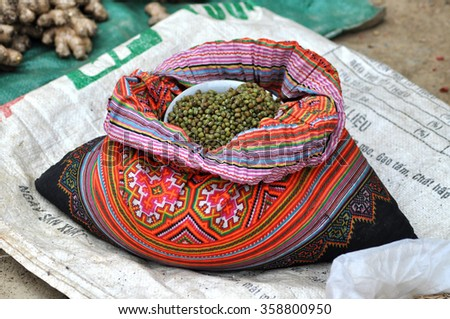 SAPA, VIETNAM - FEBRUARY 23, 2013: A bag full with dried peas on sale in the rural mountain market of Sapa, Vietnam - stock photo