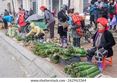 SAPA, VIETNAM â?? FEBRUARY 13: Vietnamese Red Dao women sell goods at the market on February 13, 2015 in Sapa. Sapa is famous for its rugged scenery and its cultural diversity.