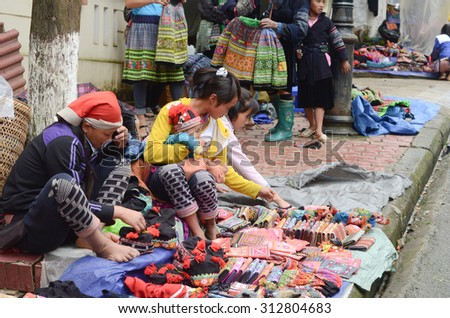 SAPA, VIETNAM, 2015 JUL 31: Unidentified Hmong women in a traditional costume work on a market.