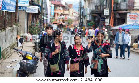 SAPA, VIETNAM - JULY 18 : Unidentified Hmong women on the main street on July 18, 2014 in Sapa, Vietnam. Hmong people are an Asian ethnic group from the mountainous regions of Vietnam.