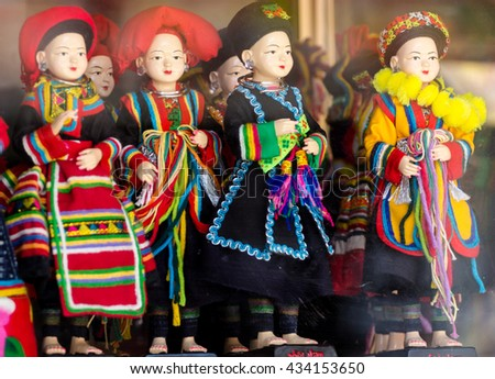 Sapa Vietnam June 8 2016 colorful dolls in traditional national costume on souvenirs shop in sapa, vietnam