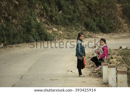 SAPA - VIETNAM, MARCH 4 : Hmong children waiting for a sale. March 4, 2016