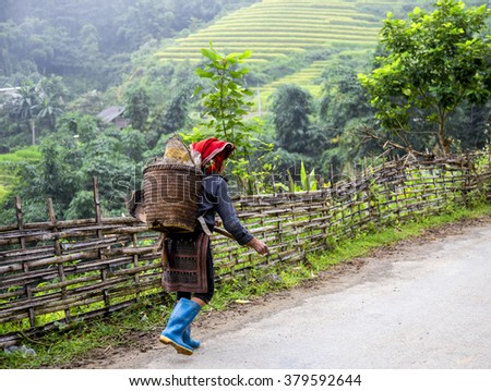 SAPA, VIETNAM - SEP 4: Hmong woman going to small market at September 4, 2015 in Sapa, Lao Cai, VIetnam.