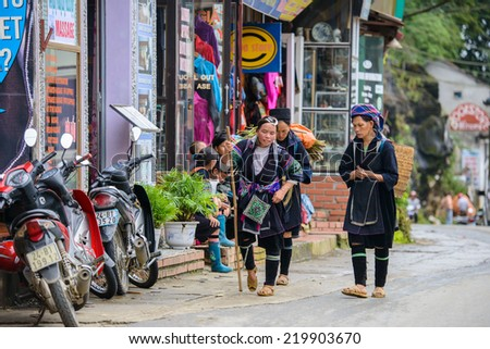 SAPA, VIETNAM - SEP 20, 2014: Unidentified Hmong women in the Hmong traditional costume. Hmong people is a minority ethnic group living in Sapa