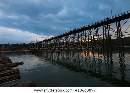 Saphan Mon, Long wooden bridge, Second longest wooden bridge in the World with sunset in the background at Sangkhlaburi in Kanchanaburi, West of Thailand.