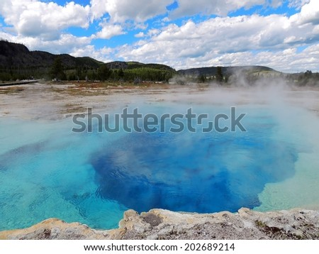 sapphire pool at biscuit basin in yellowstone national park, wyoming - stock photo