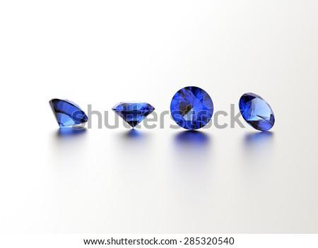 Sapphire. Round shape gemstone on  white. Jewelry background - stock photo
