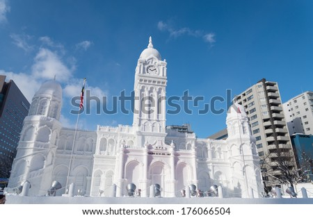 SAPPORO, JAPAN - FEB. 6 : Snow sculpture of Sultan Abdul Samad at Sapporo Snow Festival site on February 6, 2014 in Sapporo, Hokkaido, japan. The Festival is held annually at Sapporo Odori Park. - stock photo