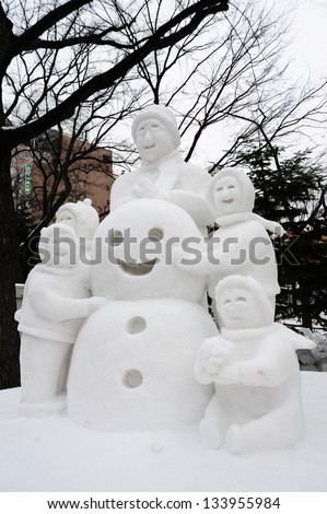 Sapporo, Japan - February 2012: The 63rd Sapporo Snow Festival at Odori Park. It was held from February 6 to 12, 2012, people come to see the hundreds of beautiful snow statues and ice sculptures. - stock photo