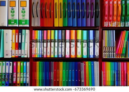 SAPPORO, JAPAN -26 JUN 2017- Colorful displays of binders and notebooks on a shelf for sale at a Japanese stationery store. Stationery items are a popular tourist souvenir from Japan.