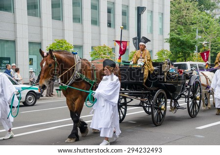 SAPPORO, JAPAN - JUNE 16, 2015 : The parade of Hokkaido Shrine Festival on June 16, 2015. Hokkaido Shrine Festival is the annual festival for summer greeting in Sapporo, Japan.