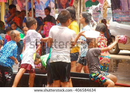 saraburi Province,Thailand April15 Songkran festival to pray for the family and children and adults can swim in the 15 April 2016 that an unidentified child
