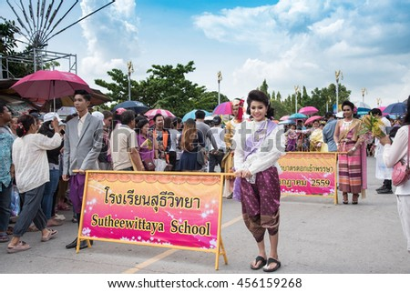 SARABURI, THAILAND-JULY 20: The parade car is decorated with many different kinds of flowers during Buddhist lent ceremony at Phrabuddhabat temple on July 20, 2016 in Saraburi, Thailand. - stock photo