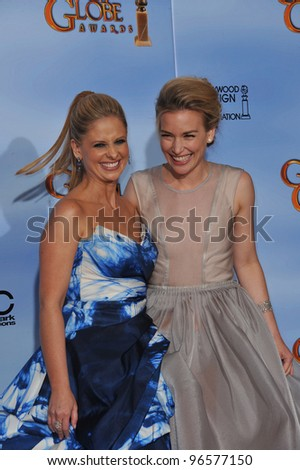 Sarah Michelle Geller & Piper Perabo at the 69th Golden Globe Awards at the Beverly Hilton Hotel. January 15, 2012  Beverly Hills, CA Picture: Paul Smith / Featureflash - stock photo