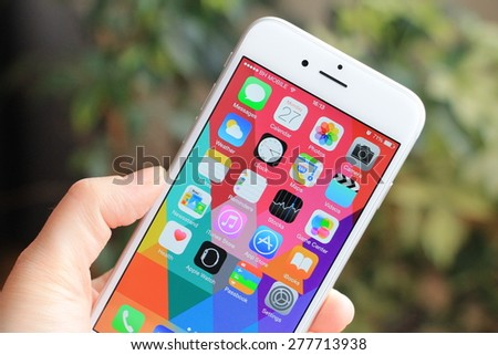 SARAJEVO , BOSNIA AND HERZEGOVINA - April 27, 2015: New gray iPhone 6 with colorful screen in woman's hand. iPhone 6 was created and developed by the Apple inc. - stock photo