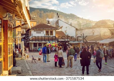 SARAJEVO, BOSNIA AND HERZEGOVINA - APRIL 19: Tourists and locals walk in old city Bascarsija area on April 19, 2015 in Sarajevo. - stock photo