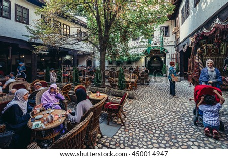 Sarajevo, Bosnia and Herzegovina - August 23, 2015. People sits in restaurant of Morica Han building located at old bazaar and the historical and cultural center of the Sarajevo called Bascarsija