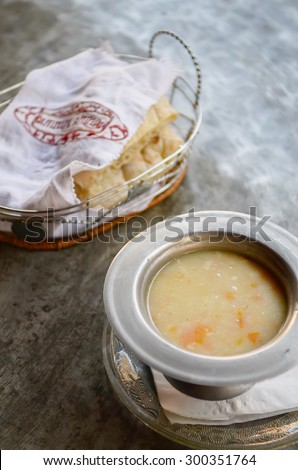 Sarajevo, Bosnia and Herzegovina- 7 July, 2014: Traditional Bosnian Cuisine - thick soup with chicken (Begova Corba), also called Bey' soup, served with Lepinja bread, Sarajevo, Bosnia and Herzegovina - stock photo