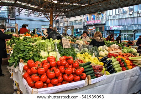 SARAJEVO, BOSNIA AND HERZEGOVINA-MAR. 20, 2015: Locals shop for produce at the Markale open market in the city which was the site of horrific bombings during the Bosnian War.