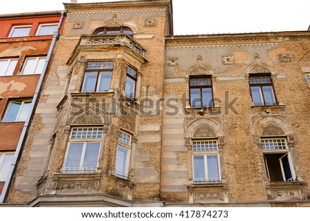 SARAJEVO, BOSNIA AND HERZEGOVINA - SEPTEMBER 4, 2009: Neglected facade of a building in Moorish revival architectural style