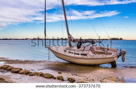 Sarasota, FL Jan 20 - Beached sailboat after tornado hit Sarasota late January, 2016 - stock photo